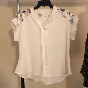 White blouse with shear shoulders